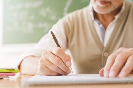 aged-math-teacher-writing-copybook_23-2148201031